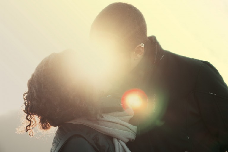 Man and women kissing