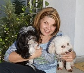 Johnnie Urban with her Dogs Shadow (Left) and Marcel (Right)